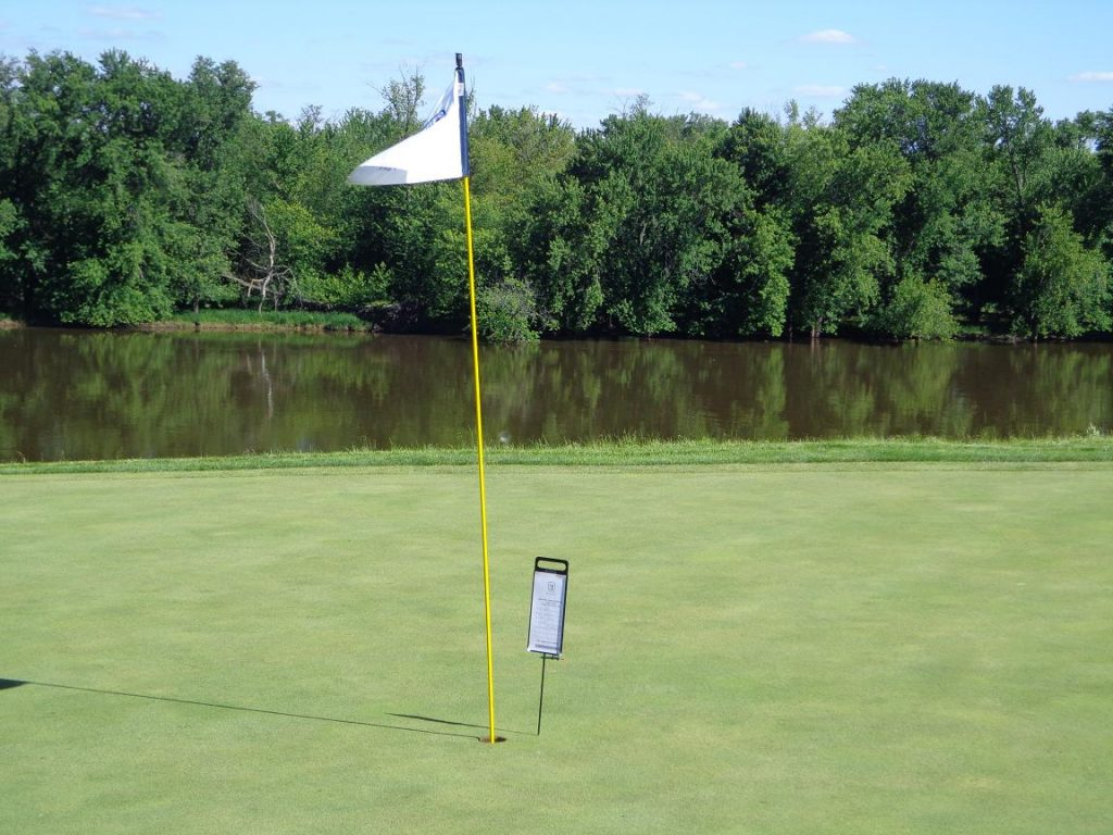 How close was it? This scene, with the Rock River in the background, shows it was just four inches BEHIND the cup.