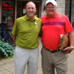 Celebrating with Greg Babinec, the pro at Michigan's Crystal Mountain, after watching Greg shoot 66 on the Montain Ridge course there.