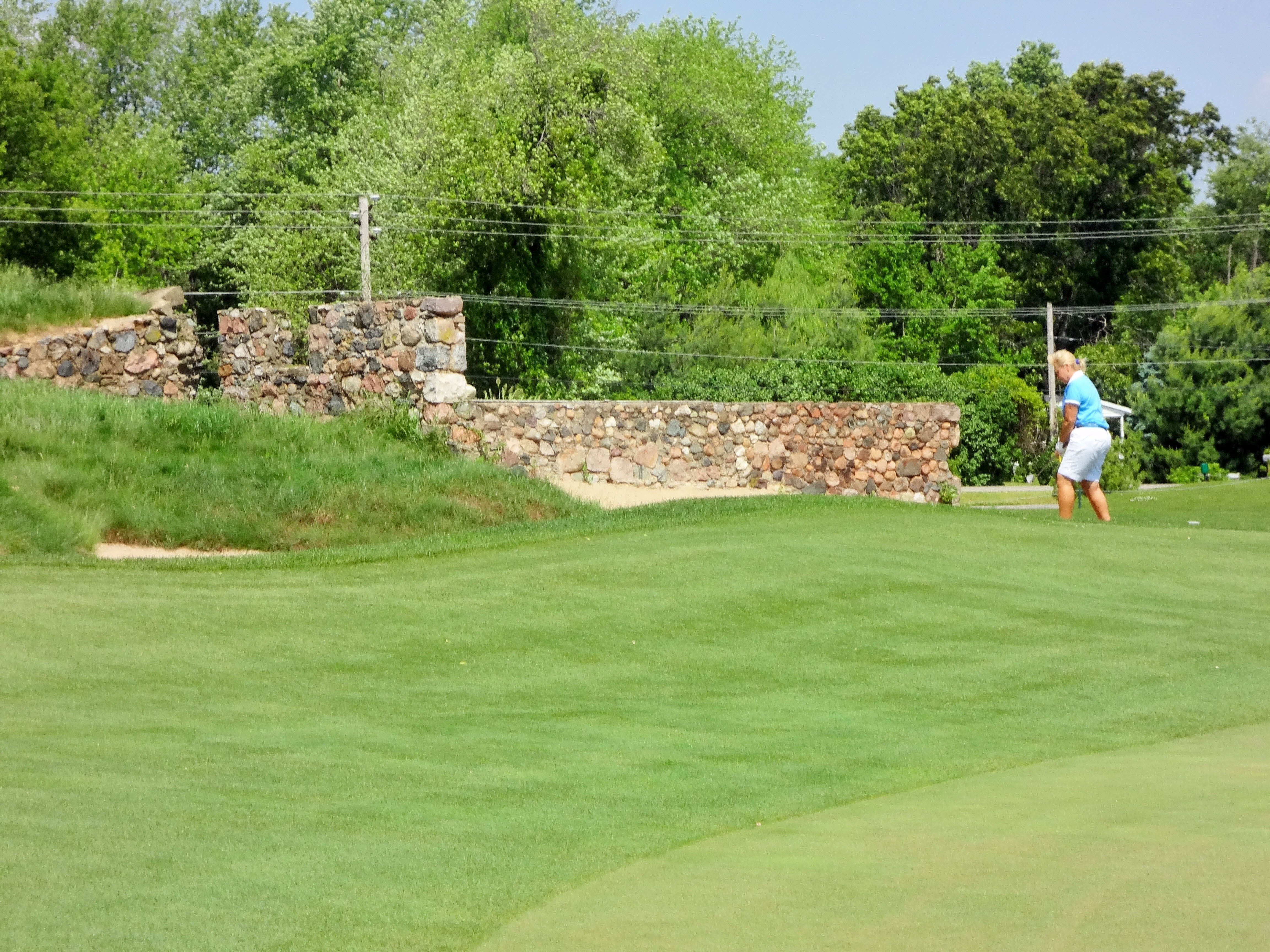 Stone from an old farmstead gives Island Hills' par-3 12th hole a distinctive look.