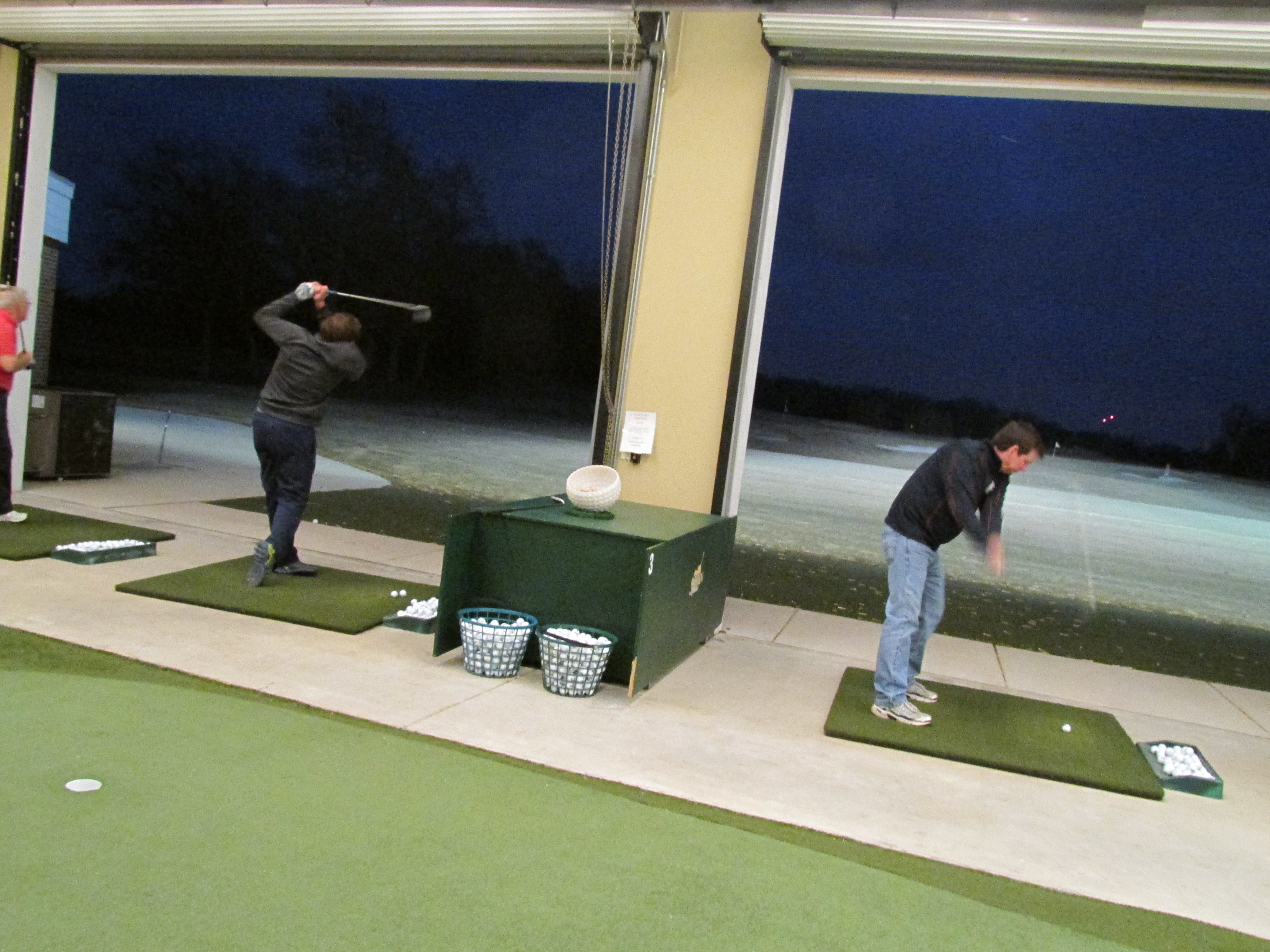 Golfers can spend and event hitting from inside into the outdoor range at Cantigny's state-of-the-art Academy.