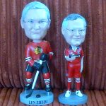 Blackhawks or Fire? Which bobble-head looks most like Len Ziehm? (I think the Fire one).
